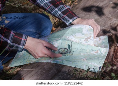 a man with a map and a compass