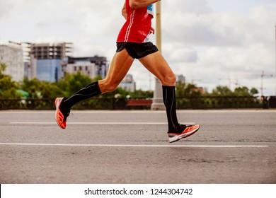 man marathon runner in compression socks running city
