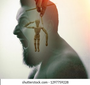 Man with marionette in his head. Concept of mind manipulation and hypnosis. Image created using double exposures.