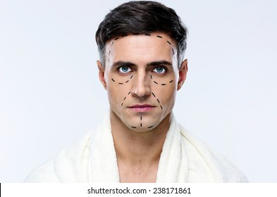 Man marked with lines for plastic surgery