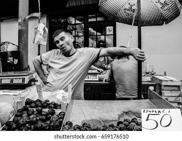 A man in the market selling plums, Belgrade, Serbia, July 2014