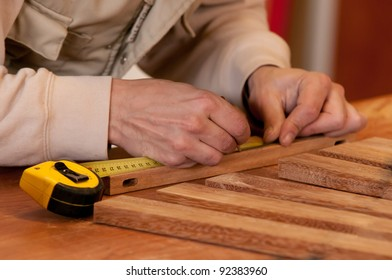 Man marking the wood