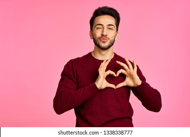 man marks the fingers of the heart