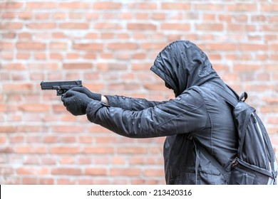 man in mask with handgun