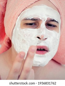 Man with a mask on his face. Cosmetics for men. Not love cosmetic procedures. Cleaning the face mask.