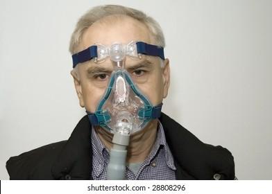 Man in a mask (sleep apnea disorder)