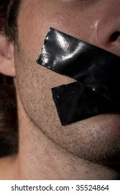 man with masking tape on his mouth