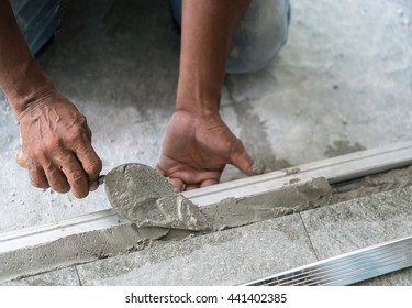 Man mason building a screed coat cement on floor