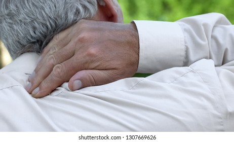 Man massaging numb neck, problems with spine, bad sleep conditions, healthcare