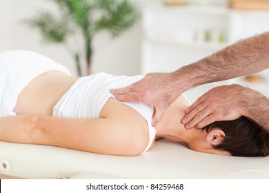 Man massaging a woman's neck in a room