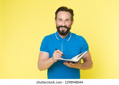 Man mature bearded guy writing notes to notepad. Check what is done. Daily schedule. Developing habits and set up routine. Checklist of tasks. Daily checklist to do and done. Helpful checklist.
