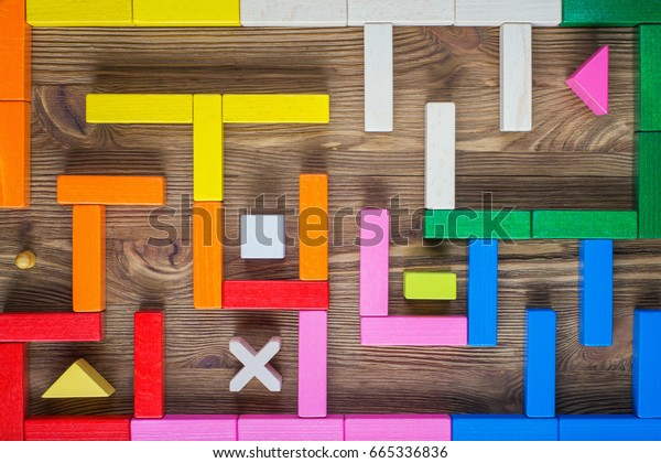 The man in the maze. The concept of a business strategy, analytics, search for solutions, the search output. Labyrinth of colorful wooden blocks.