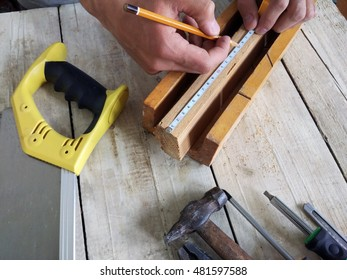 Man measures the board