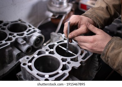 man measuring the bore of an engine with precision measuring tools