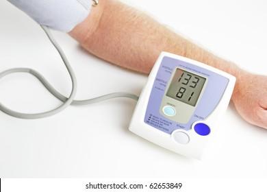 Man measuring his own blood pressure.