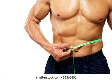 Man measuring his waistline.