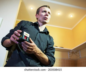 Man  measuring with laser level