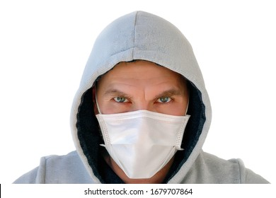man in a medical mask with an evil look isolated on a white background, a virus epidemic