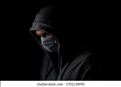 man in a medical mask on a black background, protection against coronavirus, disease prevention