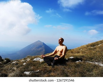 Man Meditate in Nature. Top of the Mountain. Half - Naked Man Muscles