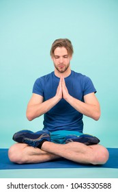 Man meditate on yoga mat, relax. Sportsman in lotus pose, meditation. Yoga, relax, meditation, zen, chakra, lotus, peace. Sport fashion, sportswear, sneakers.