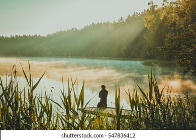 Man meditating by the lake