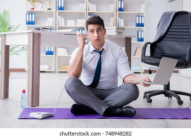 Man meditating in the office to cope with stress