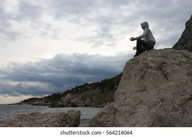 man meditating on the coast of the Black Sea.
