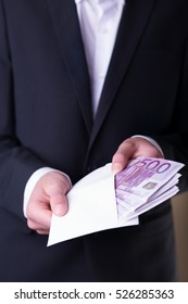 Man in Men's Suits.Bribe and corruption with euro banknotes.Wrapper with money.