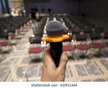 man with microphone at conference hall