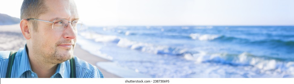 man middle age outside sea background panorama people