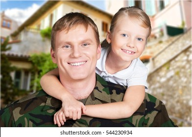 Man millitary and child.