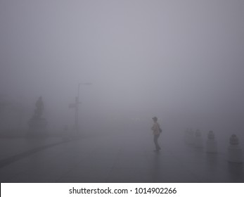 Man in the mist in Hong Kong