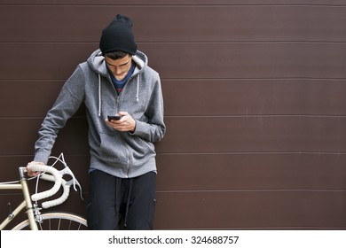 man with mobile phone and bicycle