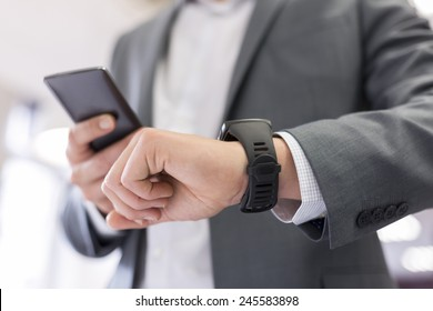 Man with Mobile phone connected to a smart watch