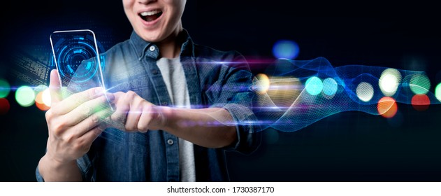 Man mobile surfing internet on mobile futuristic vibrant light background. Smart technology new normal future lifestyle,digital IOT internet of thing future AI technology smart device social network,