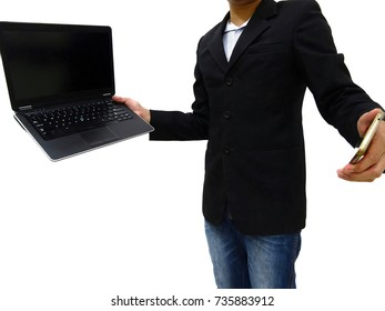 Man model in black suit is standing and holding the black computer notebook and white smartphone with each hand for posing like a work presention of officer.