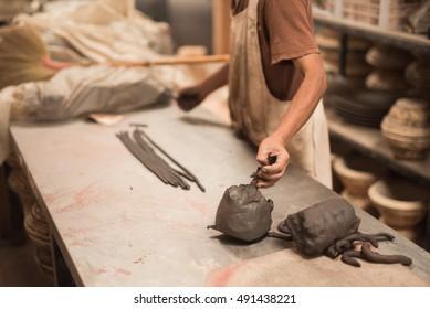 man mold baked clay