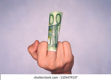 The man with the money. To show the middle finger. Brutal angry gesture. Rude, sarcastic. To give or take bribe, the bribe taker, the official, dishonest. Dishonest conduct of business.