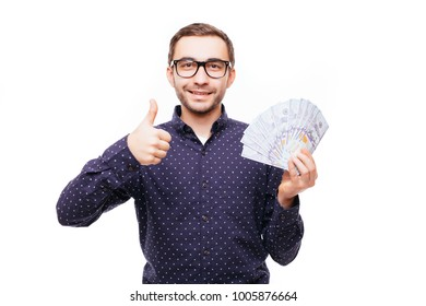 Man with money showing thumbs up isolated on white background