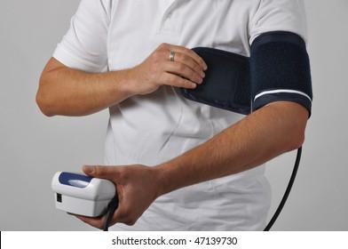 Man monitoring blood pressure with tonometer