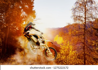 man with  motocross at sunset