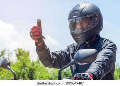 Man in a Motorcycle with helmet and gloves is an important protective clothing for motorcycling throttle control,safety concept