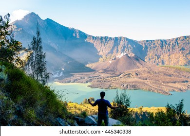 A man and Mount Rinjani