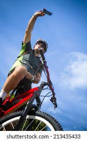 man with mountain bike take self portrait