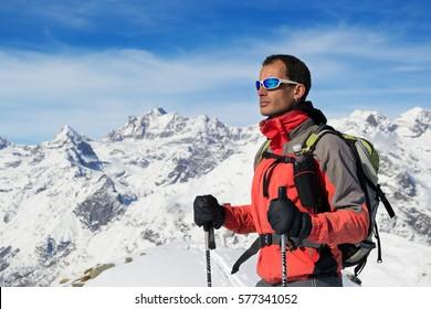 Man mountain winter clothes. Ski touring in italian Alps, Gran Paradiso National Park