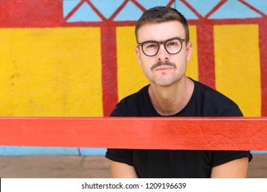 Man with moustache and eyeglasses