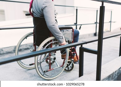 Man moving his wheelchair alone outdoors