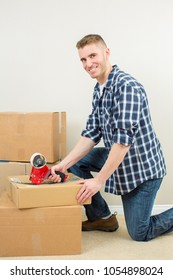 Man moving and packing boxes