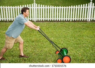 Man mowing his green lawn